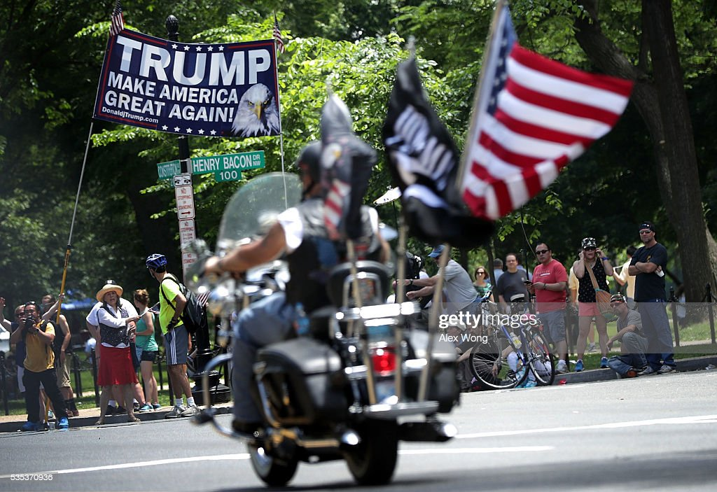 Supporters of Republican presidential candidate Donald Trump hold up a banner during the annual Rolling Thunder First Amendment Demonstration Run May 29, 2016 in Washington, DC. Bikers are gathering in the annual parade in the nation's capital to remember those who were prisoners of war and missing in action on Memorial Day weekend.
