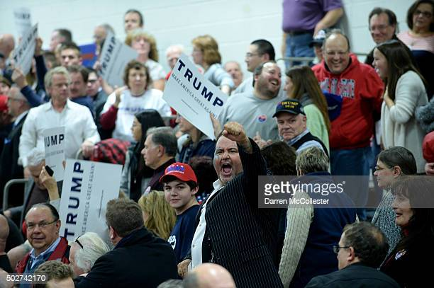 Supporters of Republican Presidential candidate Donald Trump shout after a protestor was forcefully removed at a rally at Pennichuck Middle School...