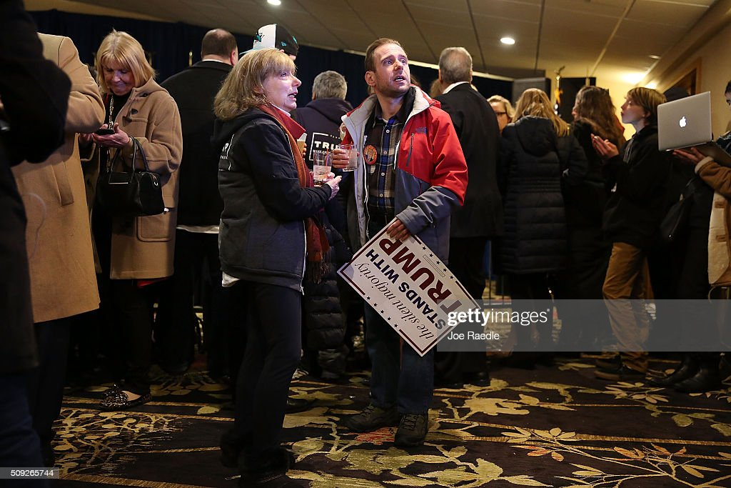 Supporters of Republican presidential candidate Donald Trump wait for results to come in on Primary day at his election night watch party at the Executive Court Banquet facility on February 9, 2016 in Manchester, New Hampshire. The process to select the next Democratic and Republican Presidential candidates continues.