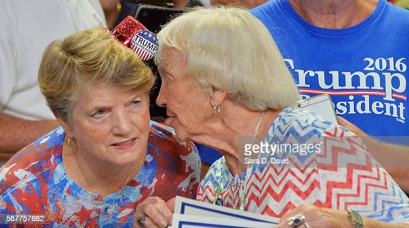 Supporters of Republican presidential candidate Donald Trump whisper during a campaign event at Trask Coliseum on August 9 2016 in Wilmington North...