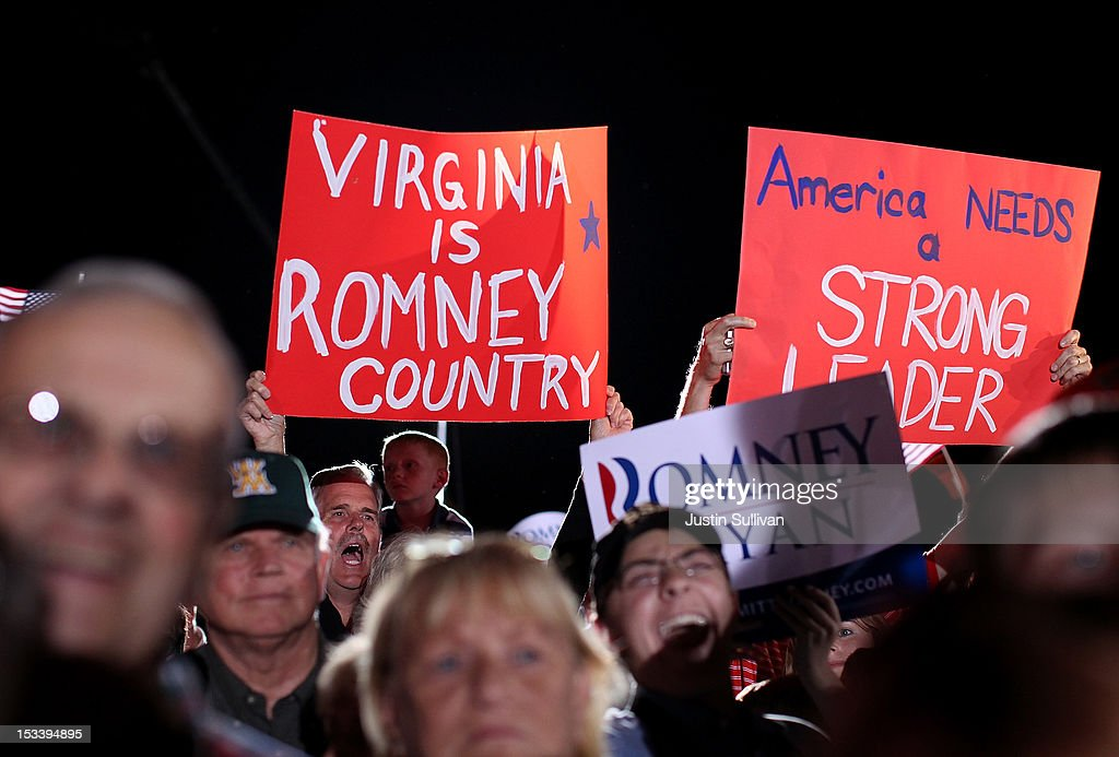 Supporters of Republican presidential candidate, former Massachusetts Gov. Mitt Romney and his running mate, U.S. Rep Paul Ryan (R-WI) hold signs during a campaign rally at the Augusta Expoland on October 4, 2012 in Fishersville, Viriginia. One day after the first Presidential debate, Romney spoke to the Conservative Political Action Conference before heading to Virginia to campaign with Ryan.
