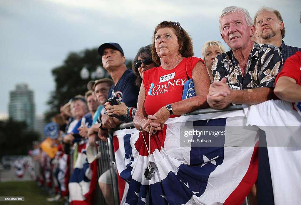 Supporters of Republican presidential candidate, former Massachusetts Gov. Mitt Romney look on during a victory rally at Pier Park on October 5, 2012 in St Petersburg, Florida. Mitt Romney is campaigning in Virginia coal country and in Florida.