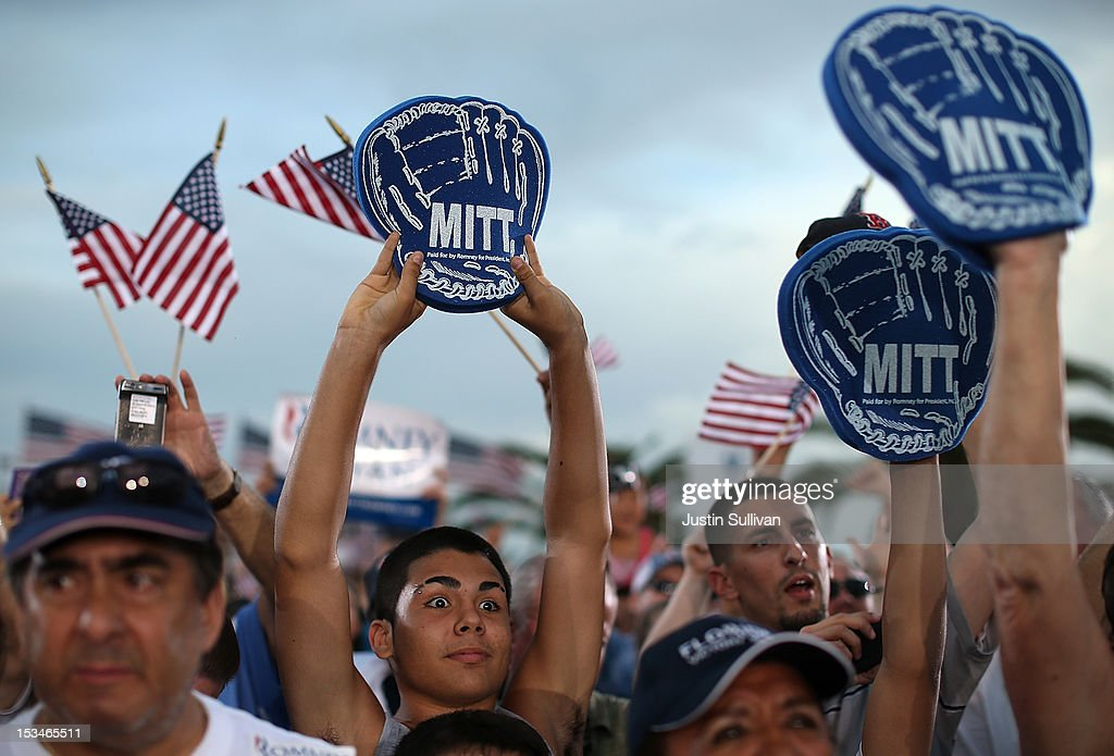 Supporters of Republican presidential candidate, former Massachusetts Gov. Mitt Romney hold signs during a victory rally at Pier Park on October 5, 2012 in St Petersburg, Florida. Mitt Romney is campaigning in Virginia coal country and in Florida.