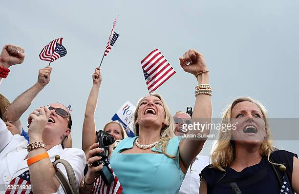 Supporters of Republican presidential candidate former Massachusetts Gov Mitt Romney cheer during a victory rally at Tradition Town Square on October...