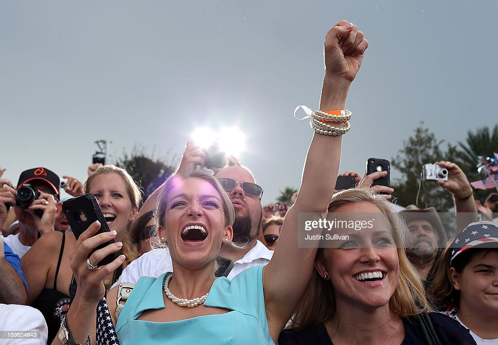 Supporters of Republican presidential candidate, former Massachusetts Gov. Mitt Romney cheer during a victory rally at Tradition Town Square on October 7, 2012 in Port St. Lucie, Florida. Mitt Romney is campaigning in Florida before traveling to Virginia where he is scheduled to give a foreign policy speech at the Virginia Military Institute.