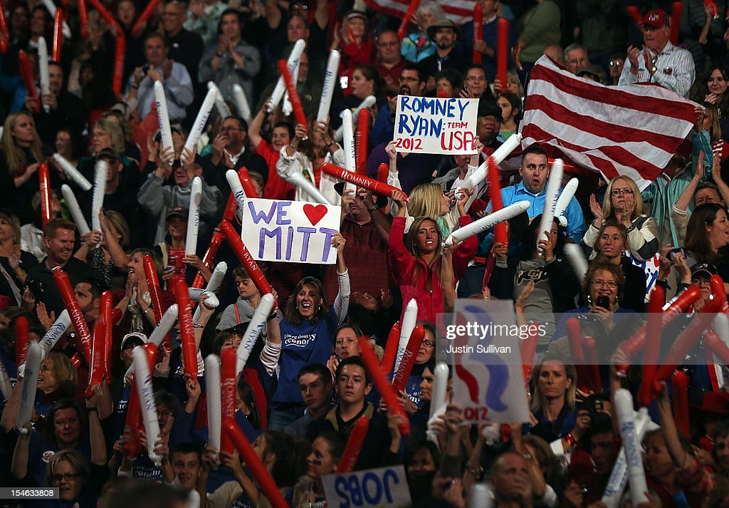 Supporters of Republican presidential candidate, former Massachusetts Gov. Mitt Romney hold signs and thunder sticks during a campaign rally at the Red Rocks Amphitheatre on October 23, 2012 in Morrison, Colorado. A day after the final Presidential debate, Mitt Romney is campaigning in Nevada and Colorado.