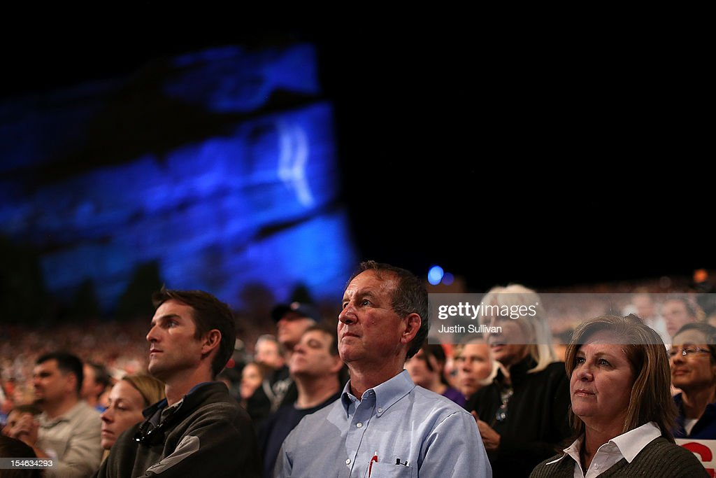 Supporters of Republican presidential candidate, former Massachusetts Gov. Mitt Romney look on during a campaign rally at the Red Rocks Amphitheatre on October 23, 2012 in Morrison, Colorado. A day after the final Presidential debate, Mitt Romney is campaigning in Nevada and Colorado.