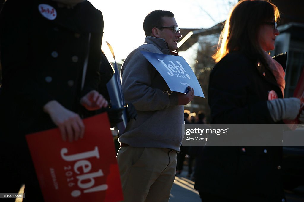 Supporters of Republican presidential candidate Jeb Bush hold signs prior to a CBS News GOP Debate February 13, 2016 outside the Peace Center in Greenville, South Carolina. Residents of South Carolina will vote for the Republican candidate at the primary on February 20.