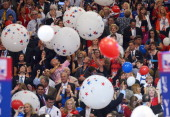 Supporters of Republican presidential candidate Mitt Romney cheer following Romney's address at the Republican National Convention at the Tampa Bay...