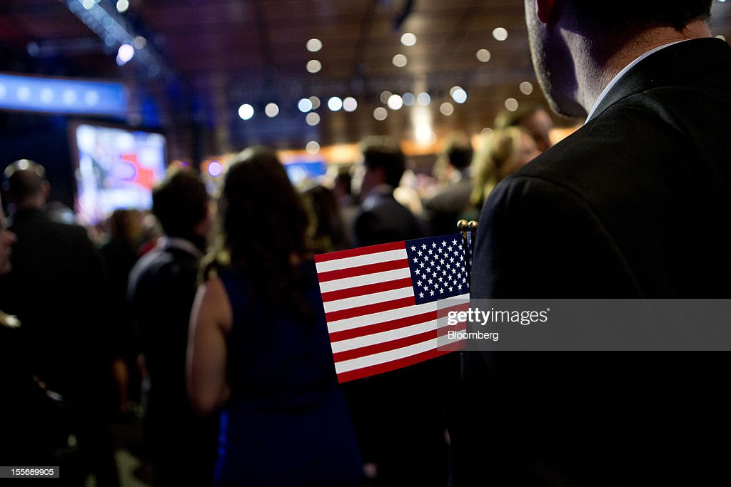 Supporters of Republican presidential candidate Mitt Romney wait for Romney to make his concession speech following the news that U.S. President Barack Obama has won re-election, at the Boston Convention and Exhibition Center in Boston, Massachusetts, U.S., in the early morning on Wednesday, Nov. 7, 2012. Obama, the post-partisan candidate of hope who became the first black U.S. president, won re-election today by overcoming four years of economic discontent with a mix of political populism and electoral math. Photographer: Andrew Harrer/Bloomberg via Getty Images