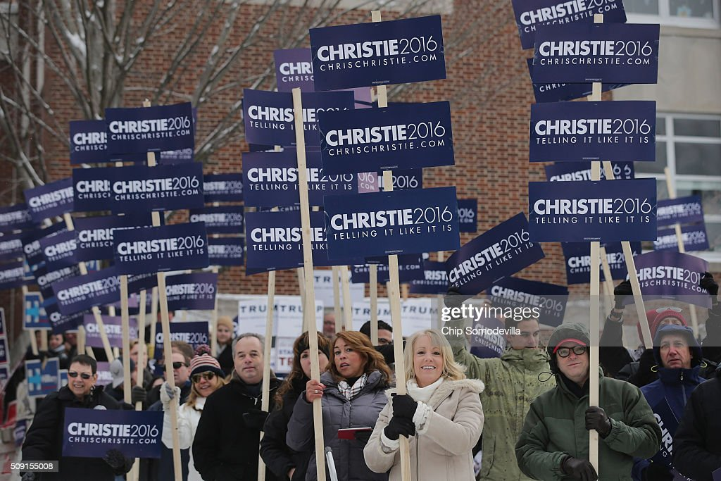 Supporters of Republican presidential candidate New Jersey Governor Chris Christie rally and chant slogans outside the polling place at Webster School February 9, 2016 in Manchester, New Hampshire. Candidates from both parties are making last-minute attempts to swing voters to their side on the day of the 'First in the Nation' presidential primary.