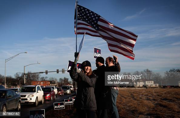 Supporters of Republican presidential candidate Rand Paul campaign for their candidate on a busy street corner during morning rush hour on February 1...
