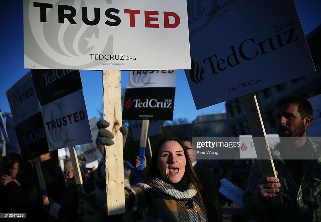 Supporters of Republican presidential candidate Sen. Ted Cruz (R-TX) shout slogans prior to a CBS News GOP Debate February 13, 2016 outside the Peace Center in Greenville, South Carolina. Residents of South Carolina will vote for the Republican candidate at the primary on February 20.