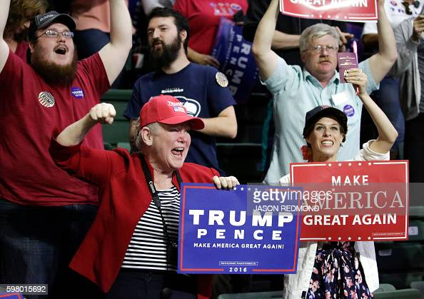 Supporters of Republican presidential nominee Donald Trump attend a rally at Xfinity Arena in Everett Washington on August 30 2016 / AFP / Jason...