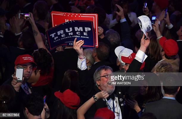 TOPSHOT Supporters of Republican presidential nominee Donald Trump cheer during election night at the New York Hilton Midtown in New York on November...
