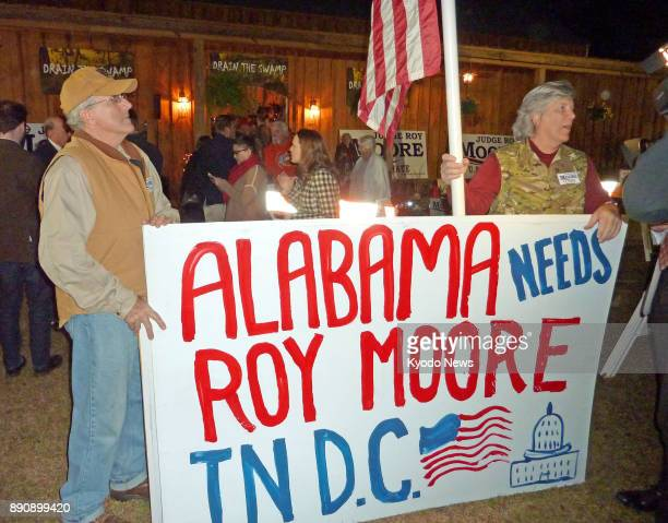 Supporters of Republican senate candidate Roy Moore stage a rally ahead of an election in Alabama on Dec 11 against his main rival Democrat Doug...