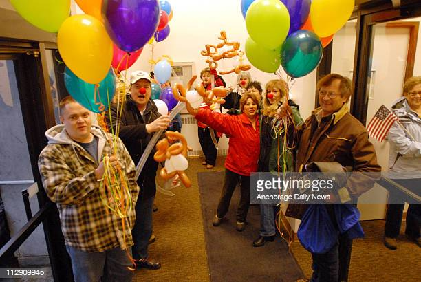 Supporters of Republican vice presidential candidate and Alaska Gov Sarah Palin hold balloons and wear clown noses as they gather in the lobby at the...