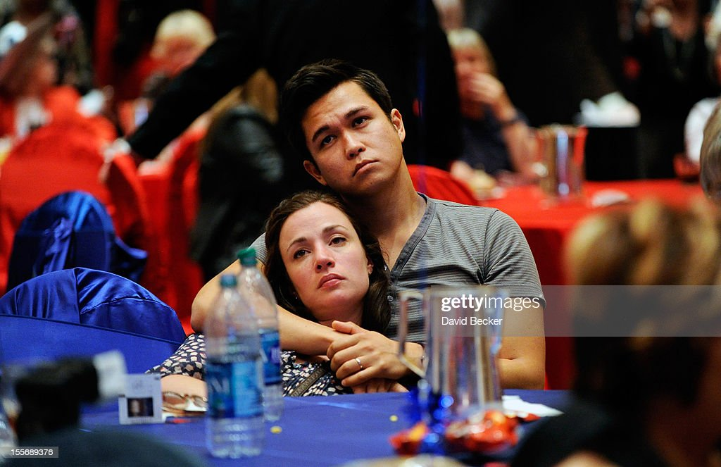 Supporters of Republician presidential candidate, former Massachuetts Gov. Mitt Romney Heidi Bischoff (L) and Paul Cimolini react after hearing that President Barack Obama was declared the winner at an election night watch party at The Venetian on November 6, 2012 in Las Vegas, Nevada. After nearly two years of presidential campaigning, U.S. citizens went to the polls today and reelected President Obama over Romney.