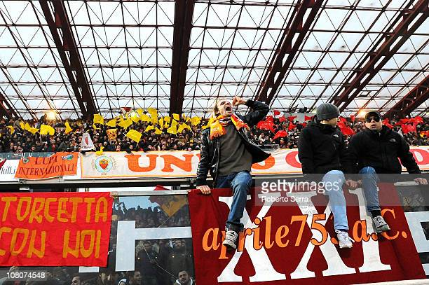 Supporters of Roma celebratese at the end of the Serie A match between Cesena and Roma at Dino Manuzzi Stadium on January 16 2011 in Cesena Italy