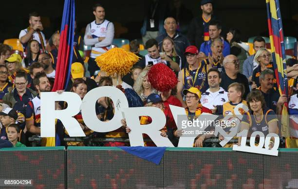 Supporters of Rory Sloane of the Crows in the crowd after he played his 150th game and winning the round nine AFL match between the Brisbane Lions...