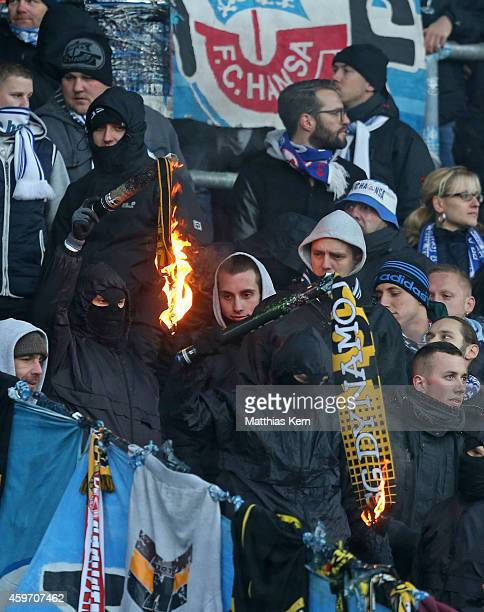 Supporters of Rostock are pictured during the third league match between FC Hansa Rostock and SG Dynamo Dresden at DKBArena on November 29 2014 in...