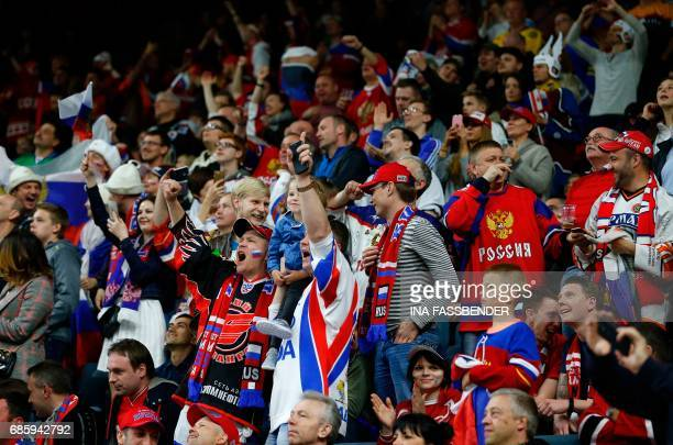 Supporters of Russia celebrate a goal against Canada during the IIHF Men's World Championship Ice Hockey semifinal match between Canada and Russia in...