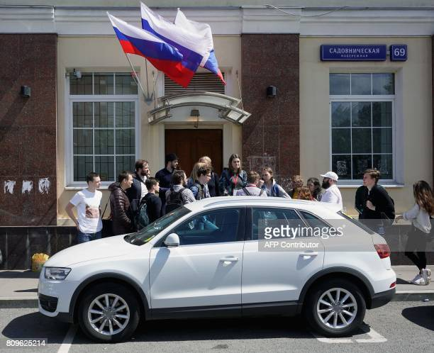 Supporters of Russian opposition leader Alexei Navalny gather outside his campaign headquarters on July 6 in Moscow Russian police were blocking the...