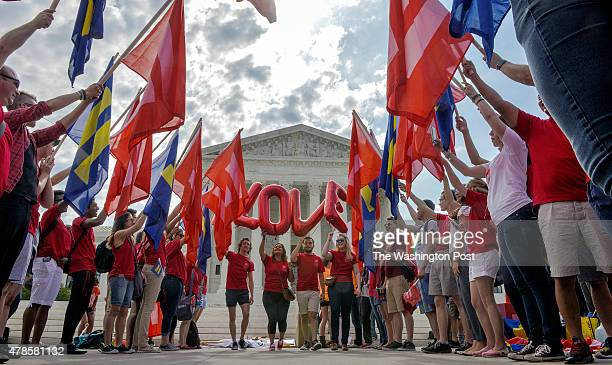 Supporters of same sex marriage rally in front of the Supreme Court awaiting a ruling to legalize gay marriage nationwide on June 2015 in Washington...
