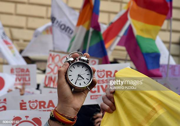 Supporters of samesex civil union hold alarm clocks 'to wake up Italia' on January 23 2016 near the Pantheon in central Rome Italy is the only major...