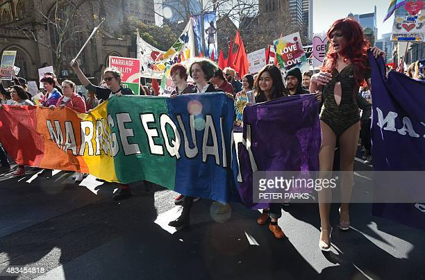 Supporters of samesex marriage attend a rally in Sydney on August 9 2015 Thousands of people rallied in Australian cities this weekend in support of...