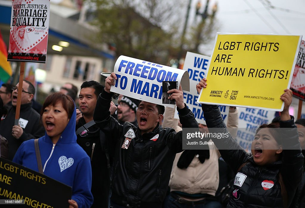 Supporters of same-sex marriage carry signs as they march during a rally in support of marriage equality on March 25, 2013 in San Francisco, California. Supporters of same-sex marriage held a rally and are set to march through San Francisco a day before the U.S. Supreme Court will hear arguments on California's Proposition 8, the controversial ballot initiative that defines marriage as between a man and a woman.