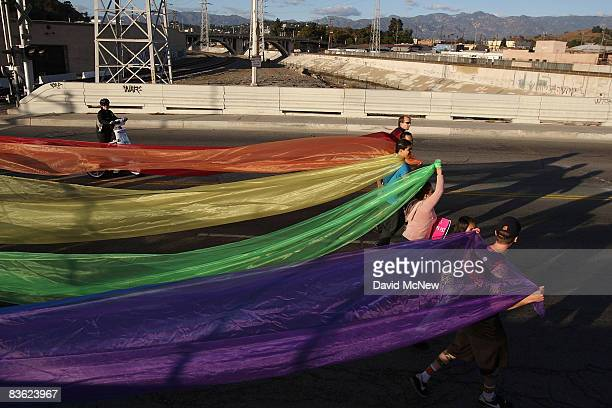 Supporters of samesex marriage organized by Latino activists cross the Main Street bridge over the Los Angeles River while marching between...