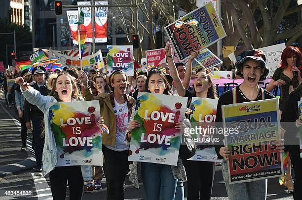 Supporters of samesex marriage shout slogans as they take part in a rally in Sydney on August 9 2015 Thousands of people rallied in Australian cities...