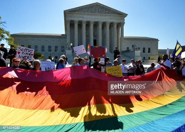 Supporters of samesex marriages gather outside the US Supreme Court waiting for its decision on April 28 2015 in Washington DC The US Supreme Court...