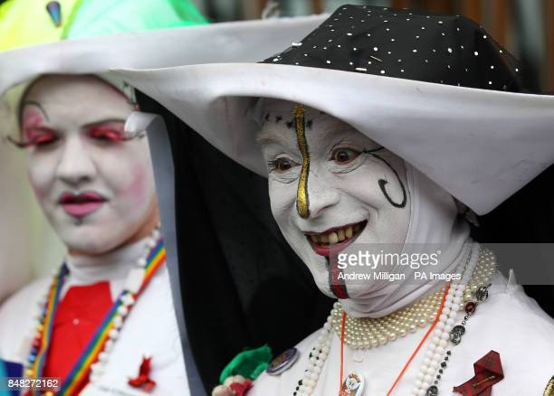 Supporters of samesex marriages Novice Ringa Fyre and Sister Pronuptia of the Sisters of Perpetual Indulgence attend the mock wedding ceremony of...