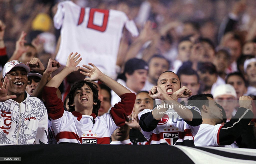 Supporters of Sao Paulo cheer their team during a match against Cruzeiro as part of the Libertadores Cup 2010 at Morumbi Stadium on May 19, 2010 in Sao Paulo, Brazil.