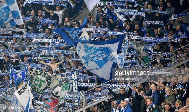 Supporters of Schalke cheer during the Bundesliga match between Bayer 04 Leverkusen and FC Schalke 04 at BayArena on April 28 2017 in Leverkusen...