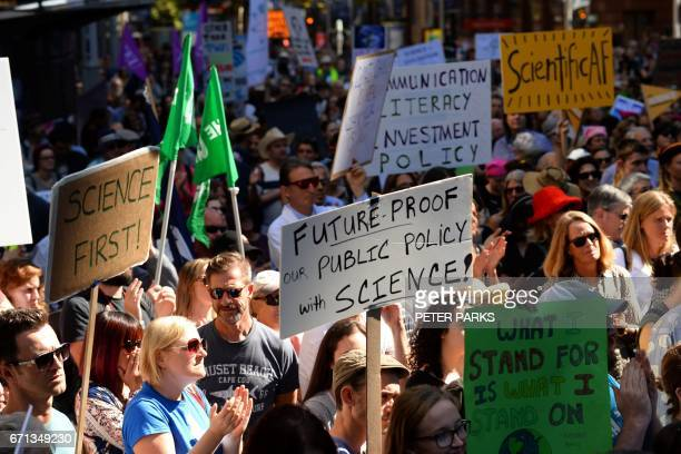 Supporters of science and research gather to take part in the March for Science protest in Sydney on April 22 2017 Thousands of people rallied in...