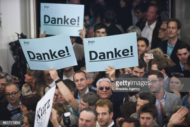 Supporters of Sebastian Kurz leader of OVP party hold banners translating 'Thanks' during the party celebration during the parliamentary elections in...