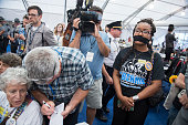 Supporters of Sen Bernie Sanders IVt stage a sitin of the press tent after walking out of the Wells Fargo Center in Philadelphia Pa on the second day...