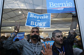 Supporters of Senator Bernie Sanders an independent from Vermont hold signs while demonstrating inside the media tent during the Democratic National...