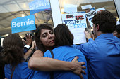 Supporters of Senator Bernie Sanders an independent from Vermont hug while demonstrating outside the media tent during the Democratic National...