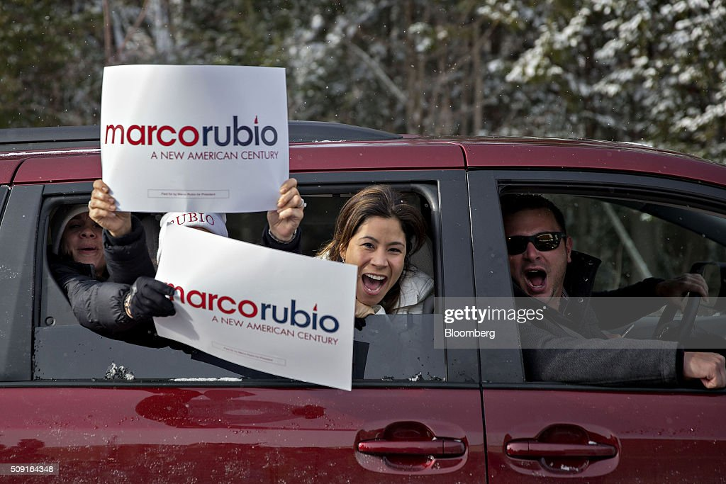 Supporters of Senator Marco Rubio, a Republican from Florida and 2016 presidential candidate, not pictured, yell from a car window while driving outside a polling station in Bedford, New Hampshire, U.S., on Tuesday, Feb. 9, 2016. Voters in New Hampshire took to the polls today in the nation's first primary in the U.S. presidential race. Photographer: Daniel Acker/Bloomberg via Getty Images