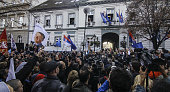 Supporters of Serbian nationalist Vojislav Seselj gather when he addresses after his arrival at Radical party headquarters in Zemun near Belgrade on...