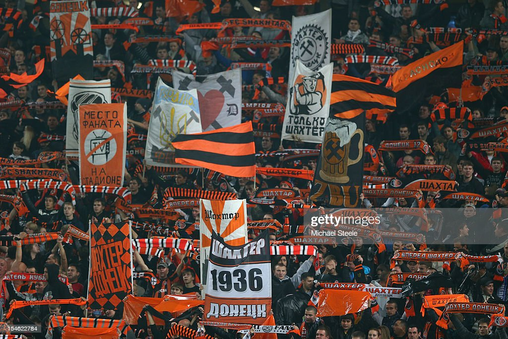 Supporters of Shakhtar Donetsk display their colours during the UEFA Champions League Group E match between Shakhtar Donetsk and Chelsea at the Donbass Arena on October 23, 2012 in Donetsk, Ukraine.