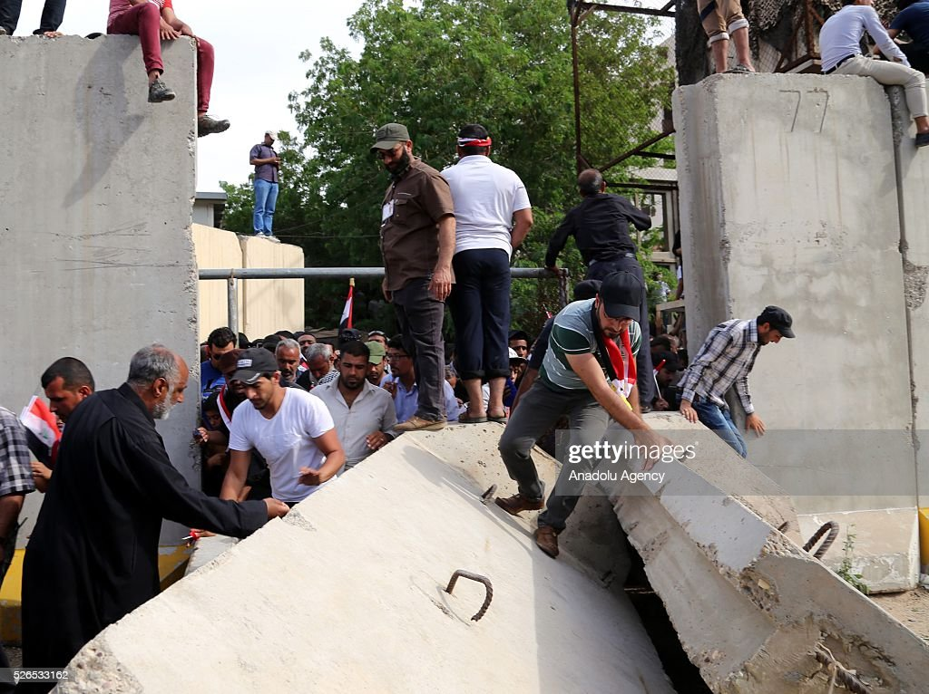 Supporters of Shia cleric Muqtada al-Sadr, demanding government reforms, enter into highly-fortified Green Zone by walking over concrete barriers, in Baghdad, Iraq on April 30, 2016.