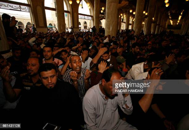Supporters of Shiite cleric Moqtada alSadr attend Friday prayers at the Great Mosque of Kufa in the city of the same name 10 kilometres northeast of...