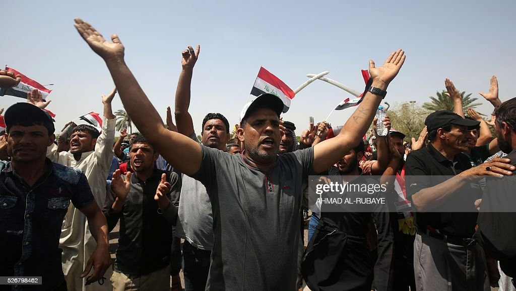 Supporters of Shiite cleric Moqtada al-Sadr gather in the parade grounds outside the parliament in Baghdad's heavily fortified 'Green Zone' on May 1, 2016, the day after supporters of Shiite cleric Moqtada al-Sadr broke into the area after lawmakers again failed to approve new ministers. Thousands of wide-eyed Iraqis marvelled at the fountains, flowers and perfect lawns in the capital's Green Zone, a day after protesters breached the walls of the fortified area. The visitors were mostly protesters who broke in but also included Baghdadis taking the opportunity to see an area that was off-limits for so many years that it acquired almost mythical status in the psyche of ordinary citizens RUBAYE