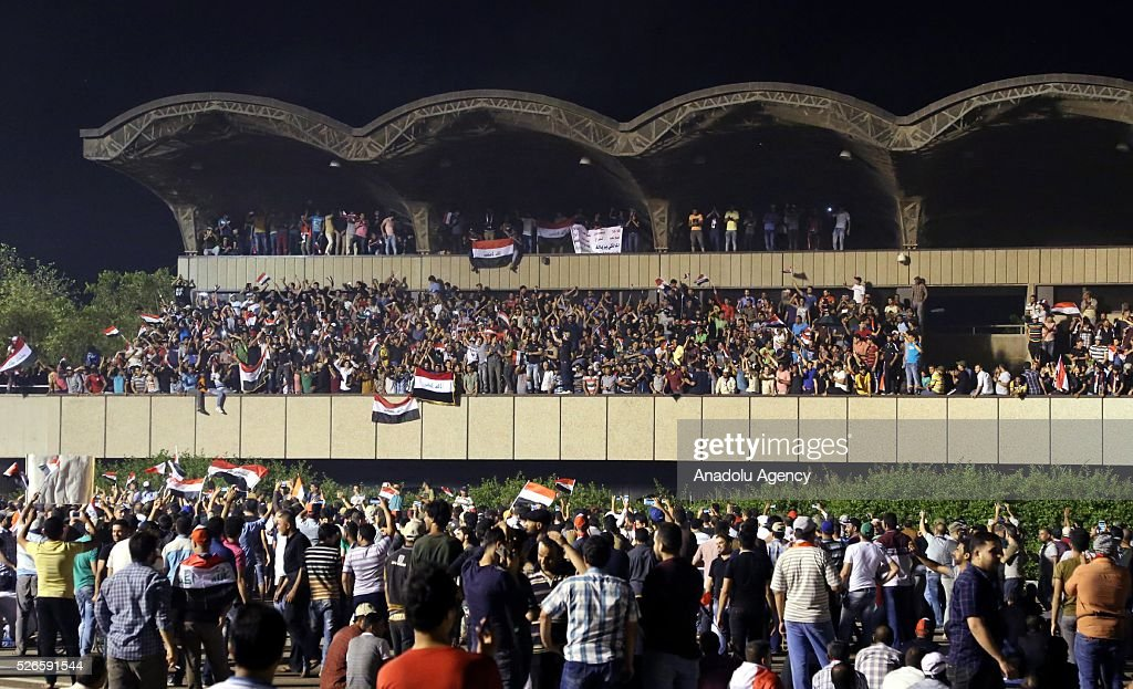 Supporters of Shiite cleric Muqtada al-Sadr gather at Grand Festivities Square in Baghdad's Green Zone on April 30, 2016. Thousands of protesters carrying Iraqi flags and chanting anti-government slogans broke into Baghdad's Green Zone and stormed the parliament building.