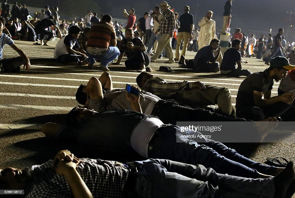 Supporters of Shiite cleric Muqtada al-Sadr sleep at Grand Festivities Square in Baghdad's Green Zone on April 30, 2016. Thousands of protesters carrying Iraqi flags and chanting anti-government slogans broke into Baghdad's Green Zone and stormed the parliament building.